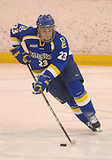 Alaska'a Bryant Mollie turns up ice with the puck during UAF's Saturday night win over LSSU.