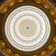 The interior dome of the Texas State Capitol building in downtown Austin, Texas. The dome makes the Texas State Capitol building the tallest of the state capitols and the only legislative building taller in the country is the U.S. Capitol in Washington DC.