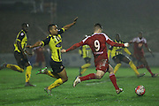 Whitehawk striker Jake Robinson crosses for the first goal during the The FA Cup 2nd Round Replay match between Whitehawk FC and Dagenham and Redbridge at the Enclosed Ground, Whitehawk, United Kingdom on 16 December 2015. Photo by Phil Duncan.