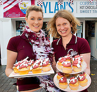 Eva Quaid , Pastry chef and manager Sandra Killeen from Dylan's coffee shop who made cup cakes with hurley and Sliotars, in Galway wearing the County colors ahead of the All Ireland Replay against Kilkenny. Photo:Andrew Downes