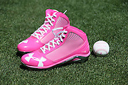 LOS ANGELES, CA - MAY 12:  Pink shoes and a baseball with pink seams lie on the grass before being used in the Los Angeles Dodgers game in honor of Mother's Day during the game against the Miami Marlins on Sunday, May 12, 2013 at Dodger Stadium in Los Angeles, California. The Dodgers won the game 5-3. (Photo by Paul Spinelli/MLB Photos via Getty Images)