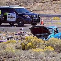 092414       Cable Hoover<br /> <br /> McKinley County Sheriff's officers process the scene of a fatal rollover crash near the 15 mile marker on Interstate Highway 40 Wednesday.
