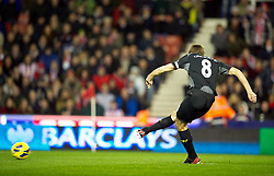 26.12.2012, Britannia Stadion, Stoke on Trent, ENG, Premier League, Stoke City vs FC Liverpool, 19. Runde, im Bild Liverpool's captain Steven Gerrard scores the first goal against Stoke City from the penalty spot during the English Premier League 19th round match between Stoke City FC and FC Liverpool at the Britannia Stadium, Stoke on Trent, Great Britain on 2012/12/26. EXPA Pictures © 2012, PhotoCredit: EXPA/ Propagandaphoto/ David Rawcliffe..***** ATTENTION - OUT OF ENG, GBR, UK *****