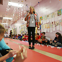 Saltillo Elementary School fourth grade teacher  Teresa Thomas tells students how to hold chopsticks as the students eat hibachi chicken and rice during their Japanese culture day at the culmination of their unit on the country and it's culture.