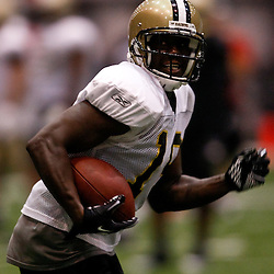 July 31, 2010; Metairie, LA, USA; New Orleans Saints wide receiver Devery Henderson (19) runs after a catch during a training camp practice at the New Orleans Saints indoor practice facility. Mandatory Credit: Derick E. Hingle