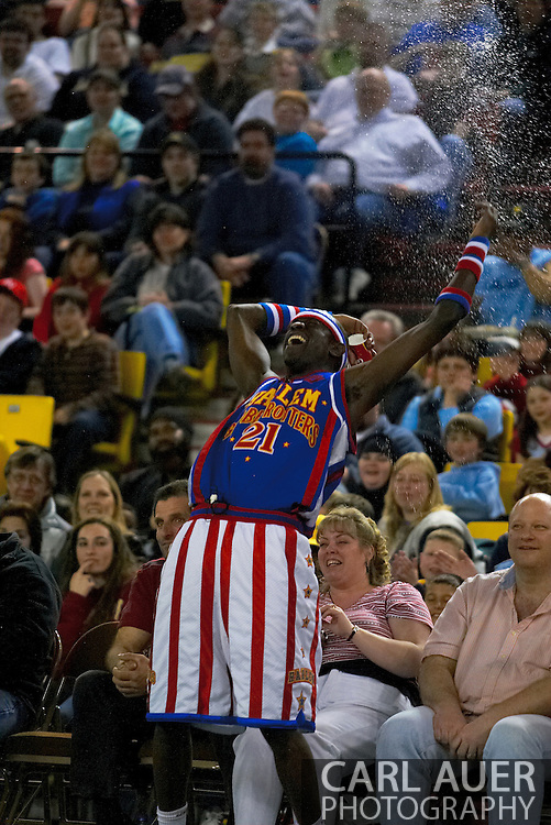 """05 May 2006: Kevin """"Special K"""" Daley throws water on the fans during the Harlem Globetrotters vs the New York Nationals at the Sulivan Arena in Anchorage Alaska during their 80th Anniversary World Tour."""
