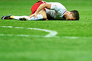 Warsaw, Poland - 2017 September 04: Robert Lewandowski from Poland lies on the pitch and holds his tibia during soccer match Poland v Kazakhstan - FIFA 2018 World Cup Qualifier at PGE National Stadium on September 04, 2017 in Warsaw, Poland.<br /> <br /> Adam Nurkiewicz declares that he has no rights to the image of people at the photographs of his authorship.<br /> <br /> Picture also available in RAW (NEF) or TIFF format on special request.<br /> <br /> Any editorial, commercial or promotional use requires written permission from the author of image.<br /> <br /> Mandatory credit:<br /> Photo by &copy; Adam Nurkiewicz / Mediasport