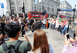 One Direction star Liam Payne (left) performing with Zedd outside Oxford Circus underground station in London.