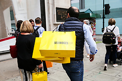 © Licensed to London News Pictures. 09/08/2019. London, UK. Shoppers with Selfridges shopping bags on Oxford Street in London as UK retailers experience worst July since sales records began. Photo credit: Dinendra Haria/LNP