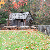 Cades Cove historic grinding mill with fall foliage colors, Great Smoky Mountains National Park, Tennessee.