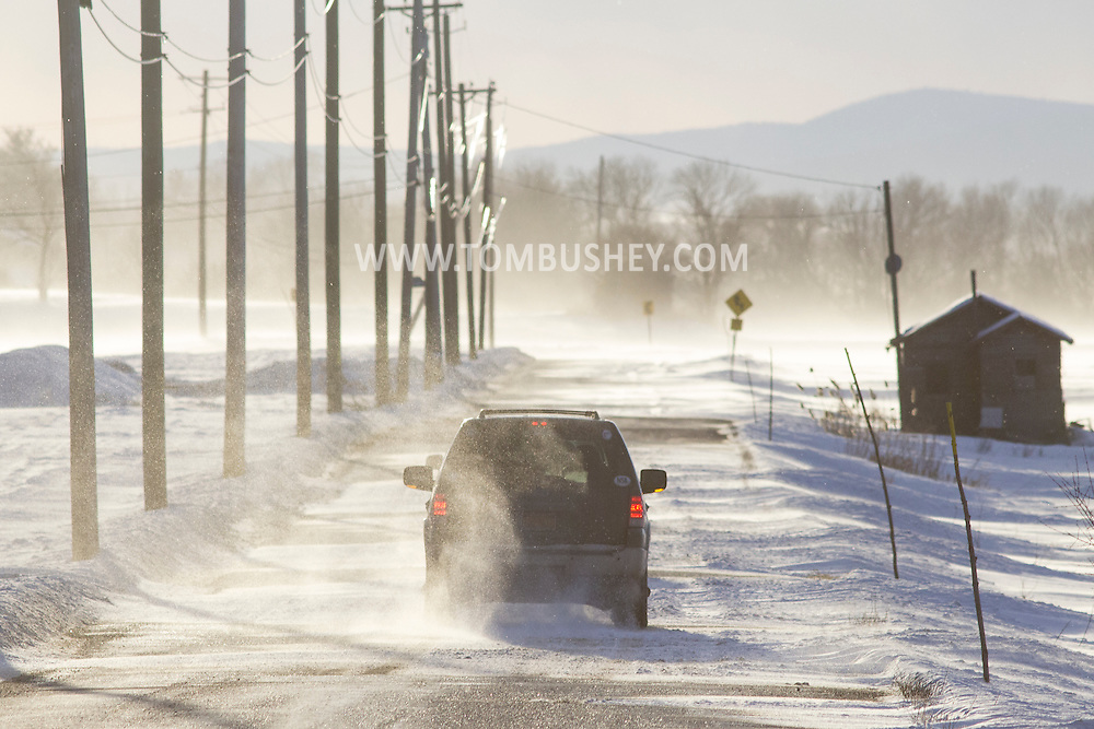 Strong northwest winds blow snow across Round Hill Road in Florida, New York on a winter afternoon.  Orange County was under a wind advisory for gusts reaching 45-50 miles per hour.