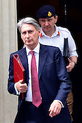© Licensed to London News Pictures. 23/05/2013. London, UK Philip Hammond, Conservative MP, Secretary of State for Defence, leaves Downing Street after a meeting of COBRA (Cabinet Office Briefing Room A) to discuss yesterday's alleged terrorist attack in Woolwich. Photo credit : Stephen Simpson/LNP