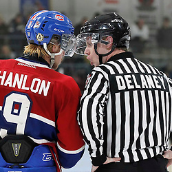 TRENTON, - Apr 2, 2016 -  Ontario Junior Hockey League game action between the Trenton Golden Hawks and the Kingston Voyageurs. Game 3 of the North East Champonship series, Jacob Hanlon #9 of the Kingston Voyageurs talks to OHA Linesman Delaney during the third period at the Duncan Memorial Gardens, ON. (Photo by Amy Deroche / OJHL Images)