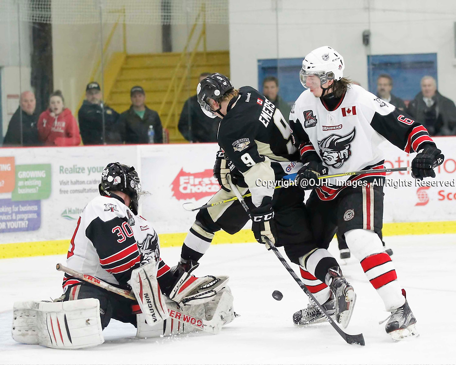 GEORGETOWN, - Apr 15, 2016 -  Ontario Junior Hockey League game action between the Trenton Golden Hawks and the Georgetown Raiders. Game 2 of the Buckland Cup Championship Series, Mitch Emerson #9 of the Trenton Golden Hawks and Jordan Crocker #9 of the Georgetown Raiders battle for the puck at the Gordon Alcott Memorial Arena, ON. (Photo by Amy Deroche / OJHL Images)