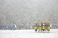 GREEN BAY,  WI - JANUARY 12:  The offensive huddle of Green Bay Packers in the snow against the Seattle Seahawks at the NFC divisional playoff game at Lambeau Field on January 12, 2008 in Green Bay, Wisconsin. The Packers defeated the Seahawks 24-17. Photo by Tom Hauck.