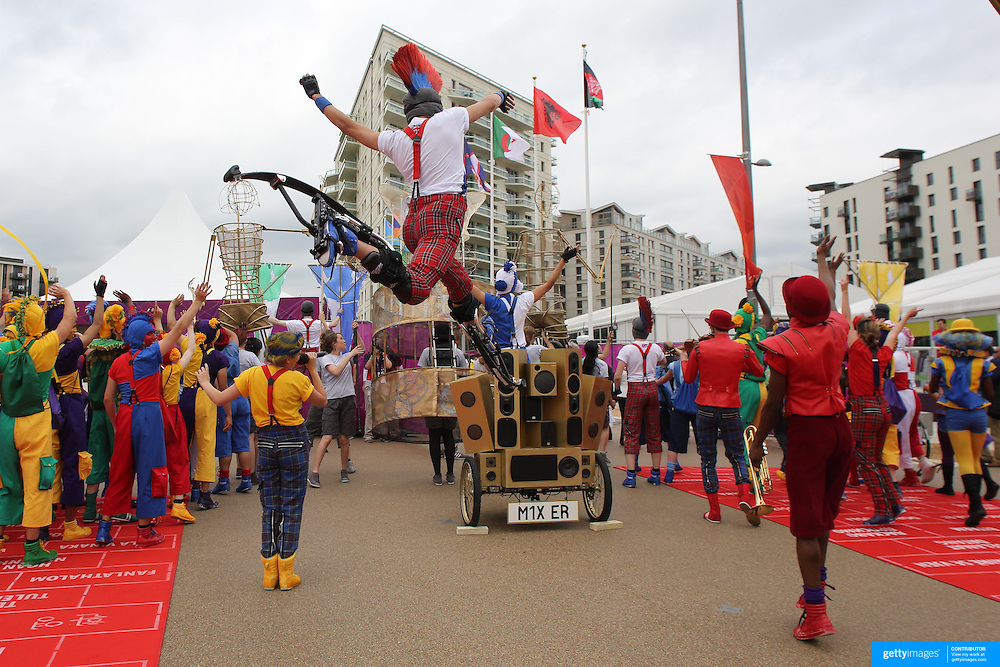 The National Youth Theatre perform a spectacular immersive performance, the first of fifty-five welcoming ceremonies, at the Athletes village as they welcome the team from British Virgin Islands at Olympic Park, Stratford during the London 2012 Olympic games preparation. London, UK. 17th July 2012. Photo Tim Clayton