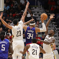 Oct 23, 2018; New Orleans, LA, USA; Los Angeles Clippers forward Tobias Harris (34) is defended by New Orleans Pelicans forward Anthony Davis (23) and forward Julius Randle (30) during the second half at the Smoothie King Center. The Pelicans defeated the Clippers 116-109. Mandatory Credit: Derick E. Hingle-USA TODAY Sports