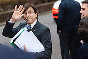 Elio Di Rupo, Prime minister of Belgium waving,waits for a car leaving the  EU Budget summit at the European Council building for a break in Brussels, Friday, Feb. 8, 2013. A European Union summit to decide EU spending for the next seven years entered a second day after all-night negotiations left a standoff over spending unresolved. The leaders of the 27 nations inched toward a compromise Friday that would leave their common budget with a real-term cut for the first time in the EU's history.