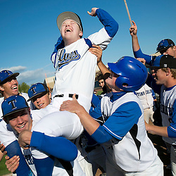 Eddie Gordon, the Timberline batboy who was born with Down syndrome is lifted into the air by his teammates after rounding the bases during his turn as a  honorary lead-off batter on Senior night against Centennial. Monday April 28, 2014