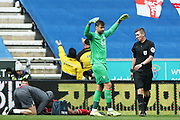 Wigan Athletic goalkeeper David Marshall (1) makes his point to Referee Matthew Donohue during the EFL Sky Bet Championship match between Wigan Athletic and Nottingham Forest at the DW Stadium, Wigan, England on 20 October 2019.