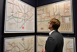 © Licensed to London News Pictures. 03/10/2017. London, UK. A man views original London Underground tube line diagrams by designer Harry C Beck on the Maltby Maps stand at the Decorative Antiques & Textiles Fair taking place at Evolution in Battersea Park which runs 3-8 October 2017 and features more than 160 exhibitors. Photo credit : Stephen Chung/LNP