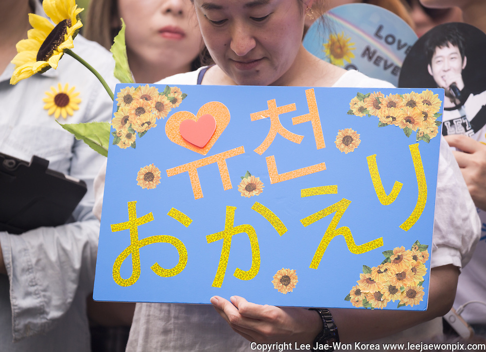 Fans of K-pop singer and actor Park Yu-chun, a member of boy band JYJ, wait for Park before he speaks in front of the media and fans at Gangnam Ward Office in Seoul, South Korea, Aug 25, 2017, as he is discharged from his two-year mandatory military service. Yu-chun has worked for the ward office of Seoul as an alternative to his military duty. Yu-chun was embroiled in a scandal in June, 2016 while in the middle of his military duty as four different women who were working at bars, lodged complaints against him, asserting he raped them. Yu-chun was later cleared of the charges. He will marry Hwang Hana, a granddaughter of founder of Namyang Dairy Product Co. in September, 2017, local media reported. Photo by Lee Jae-Won (SOUTH KOREA) www.leejaewonpix.com