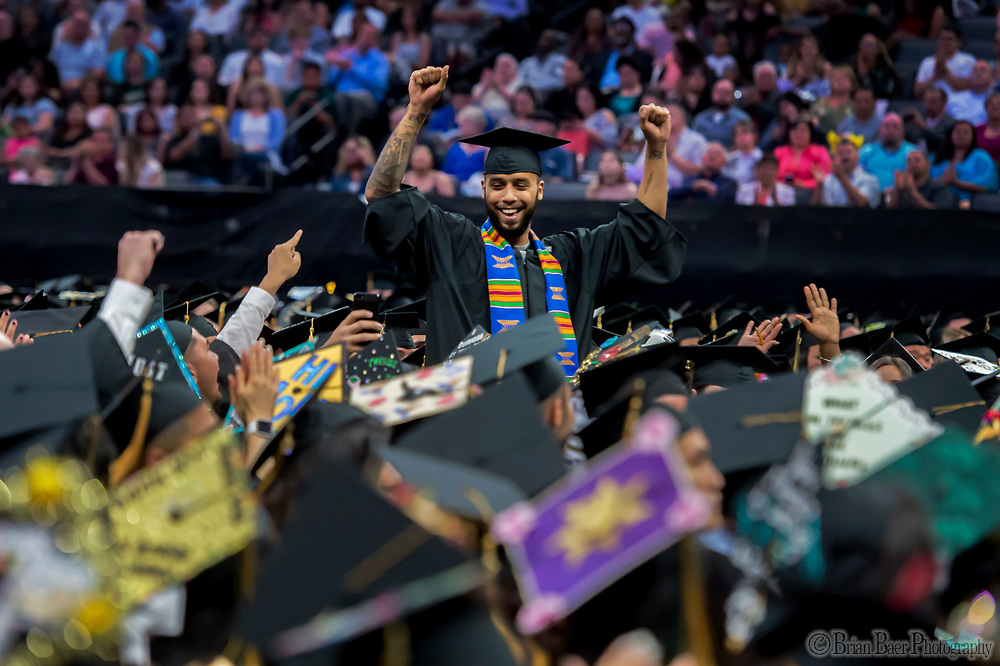 Anthony Sadler greets the crowd after he was introduced by Sacramento State President Robert S. Nelson, during the Sacramento State University graduation ceremony at Golden 1, Saturday May 20, 2017.  Anthony Sadler is the hometown hero of French train fame.<br /> photo by Brian Baer