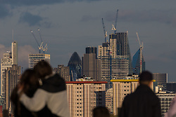 Construction cranes viewed from Primrose Hill still seem to be in evidence on London's skyline although reports suggest that construction has hit a downturn in the capital whilst surging in other parts of the country. London, May 02 2018.