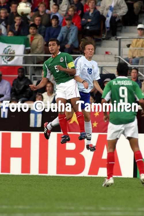 16.08.2003, T??l? Stadium, Tampere, Finland.FIFA U-17 World Championship - Finland 2003.Match 12: Group A - Finland v Mexico.Alberto Ram'rez (Mexico) v Jarkko Hurme (Finlad).©Juha Tamminen
