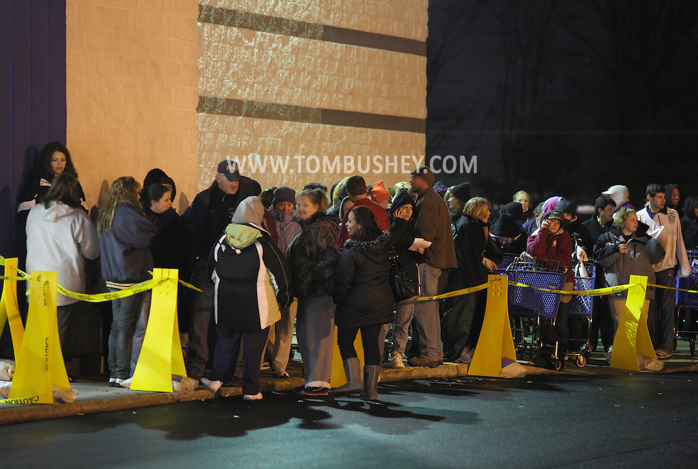 Town of Wallkill, New York - People wait in line to get into a Toy R Us store on Thanksgiving night to get an early start on their Black Friday shopping on Nov. 25, 2010. The store opened at 10 p.m.