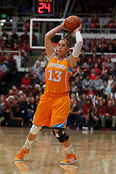 Dec 20, 2011; Stanford CA, USA;  Tennessee Lady Volunteers guard Taber Spani (13) passes the ball against the Stanford Cardinal during the first half at Maples Pavilion.  Stanford defeated Tennessee 97-80. Mandatory Credit: Jason O. Watson-US PRESSWIRE