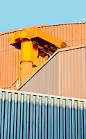 Colorful building facades and machinery at the Werdhölzli Sewage Plant, Zürich, Switzerland.
