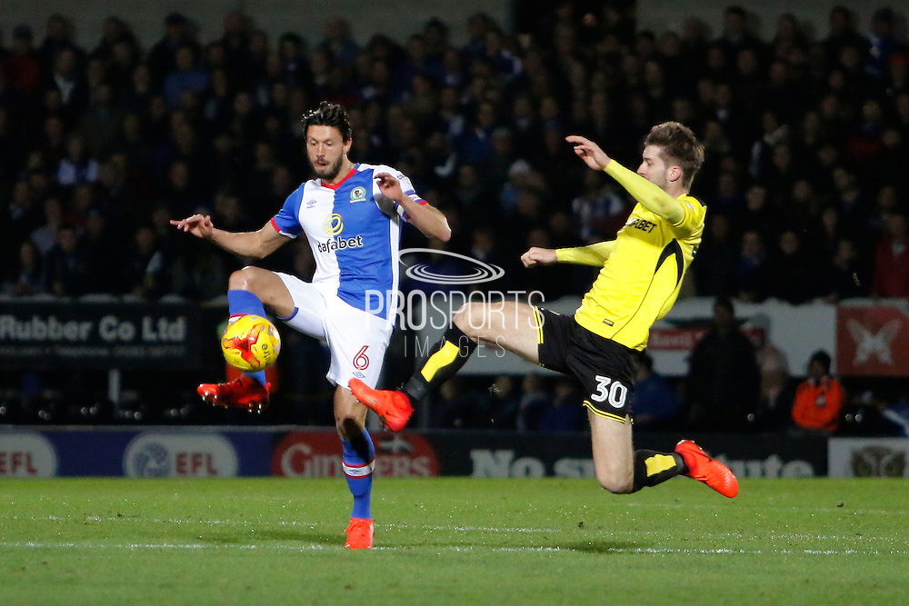 Burton Albion midfielder Luke Murphy (30) makes a tackle on Blackburn Rovers midfielder Jason Lowe (6) during the EFL Sky Bet Championship match between Burton Albion and Blackburn Rovers at the Pirelli Stadium, Burton upon Trent, England on 24 February 2017. Photo by Richard Holmes.