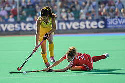 Anna Flanagan of Australia beats England's Ashleigh Ball during the Final of the Investec Hockey World League Semi Final 2013, London, UK on 30 June 2013. Photo: Simon Parker