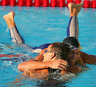 South Africa's Roland Schoeman (L) and Croatia's Duje Draganja (R) congratulate each other after swimming in the semi-final of the men's 50m Butterfly at the FINA World Championships in Montreal, Canada Sunday 24 July, 2005. Both Schoeman and Draganja qualified for the final.