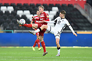 George Saville (22) of Middlesbrough battles for possession with George Byers (28) of Swansea City during the EFL Sky Bet Championship match between Swansea City and Middlesbrough at the Liberty Stadium, Swansea, Wales on 14 December 2019.