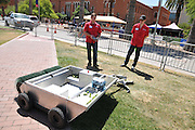 Team 15094 members demonstrate their Macadamia Nut Harvester during Design Day 2016.