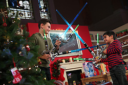 © Licensed to London News Pictures. 04/11/2015. London, UK. Boys play with Blade Builders Jedi Master Light Sabres at the Dream Toys Christmas event. Photo credit: Peter Macdiarmid/LNP