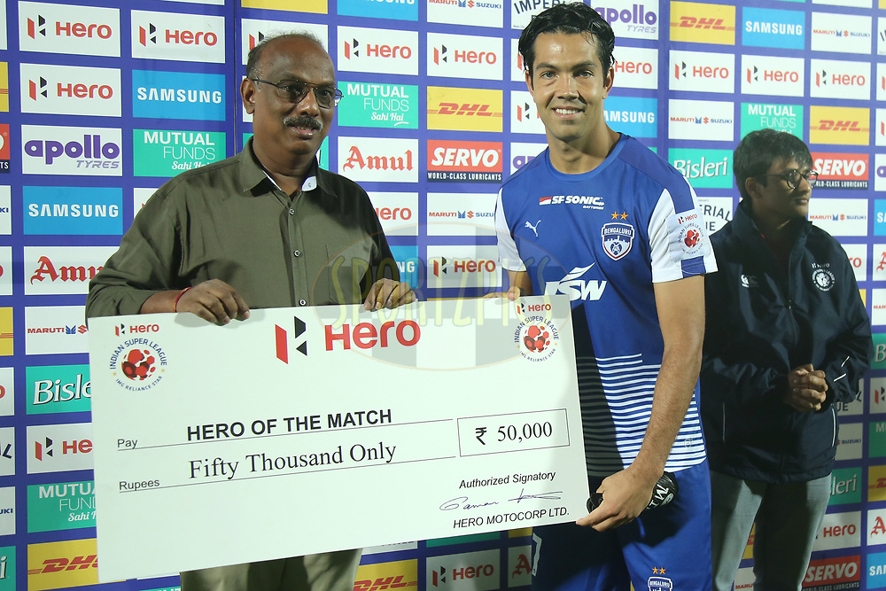 Nicolas Ladislao Fedor of Bengaluru FC receive Hero of the match award during match 19 of the Hero Indian Super League between NorthEast United FC and Bengaluru FC held at the Indira Gandhi Athletic Stadium, Guwahati India on the 8th December 2017<br /> <br /> Photo by: Deepak Malik  / ISL / SPORTZPICS