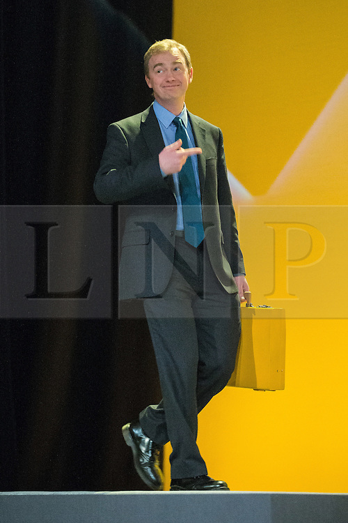 © Licensed to London News Pictures . 15/03/2015 . Liverpool , UK . TIM FARRON at the conference with a yellow ministerial box . The Liberal Democrat Party Conference at the Arena and Conference Centre in Liverpool . Photo credit : Joel Goodman/LNP