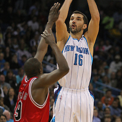 Jan 29, 2010; New Orleans, LA, USA; New Orleans Hornets forward Peja Stojakovic (16) shoots over Chicago Bulls forward Luol Deng (9) during the second half at the New Orleans Arena. The Bulls defeated the Hornets 108-106 in overtime. Mandatory Credit: Derick E. Hingle-US PRESSWIRE