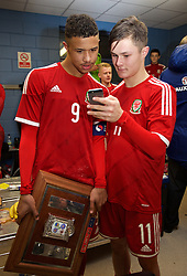 BALLYMENA, NORTHERN IRELAND - Thursday, November 20, 2014: Wales' goalscorer watch their goals as they celebrate with the Victory Shield trophy after beating Northern Ireland 2-0 during the Under-16's Victory Shield International match at the Ballymena Showgrounds. (Pic by David Rawcliffe/Propaganda)