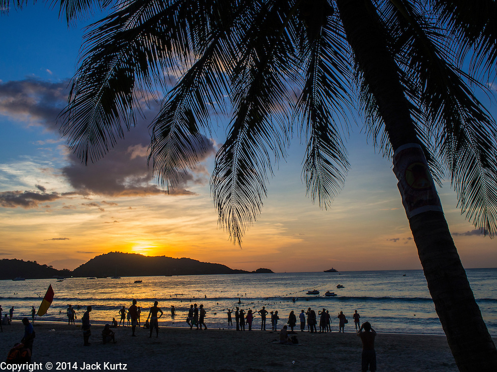27 DECEMBER 2014 - PATONG, PHUKET, THAILAND: Sunset on Patong beach. Patong Beach is the largest beach on Phuket island. It's popular with tourists from Australia and Europe. In recent years it has become a leading destination for Russian tourists.    PHOTO BY JACK KURTZ