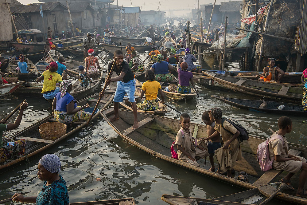 A busy channel crowded with boats in Makoko.
