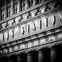 Union Station Chicago sign and building in black and white. Union Station opened in 1925 and serves as a train station for commuter trains.