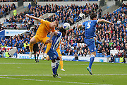 Preston Eoin Doyle and Brighton & Hove Albion defender Gaetan Bong (12) and Brighton & Hove Albion defender Lewis Dunk (5) battle in the air during the Sky Bet Championship match between Brighton and Hove Albion and Preston North End at the American Express Community Stadium, Brighton and Hove, England on 24 October 2015. Photo by Phil Duncan.