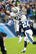 NASHVILLE, TN - NOVEMBER 29:  Amari Cooper #89 of the Oakland Raiders catches a pass in front of Coty Sensabaugh #24 of the Tennessee Titans at Nissan Stadium on November 29, 2015 in Nashville, Tennessee.  (Photo by Wesley Hitt/Getty Images) *** Local Caption *** Amari Cooper; Coty Sensabaugh
