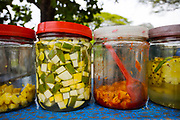 Jars of manga achar - pickled pineapple and mango - ready to be served up with salt and chilli as a street food snack, Fort Kochi, Cochin, Kerala, Southern India