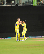 Doug Bollinger and Suresh Raina celebrate a wicket falling during match 13 of the Airtel CLT20 between The Superkings and the Victorian Bushrangers held at St Georges Park in Port Elizabeth on the 18 September 2010..Photo by: Deryck Foster/SPORTZPICS/CLT20