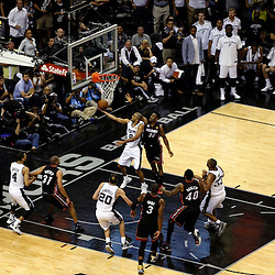 Jun 16, 2013; San Antonio, TX, USA; San Antonio Spurs point guard Tony Parker (9) shoots against Miami Heat point guard Norris Cole (30) during the second quarter of game five in the 2013 NBA Finals at the AT&T Center. Mandatory Credit: Derick E. Hingle-USA TODAY Sports